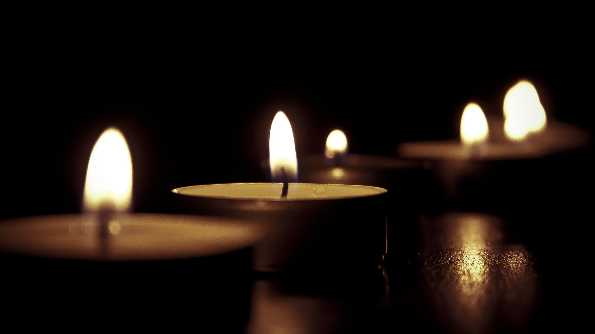 Candles burning in the dark