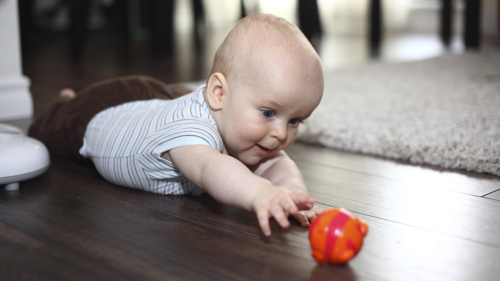 Baby reaching for toy
